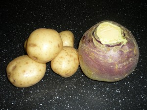 Photo of potatoes and a swede