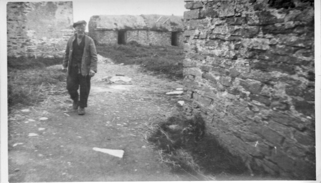 Photograph of Sandy Johnston in the steading at Greenquoy, North Walls