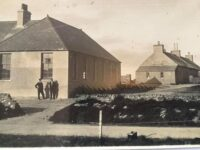 Photo showing the new 1932 school and the older 1867 school, North Walls, Orkney